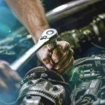 car mechanic fixing engine